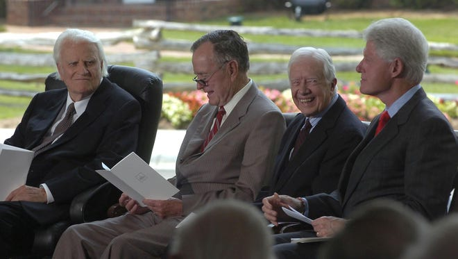 Billy Graham, left talks with former presidents George H.W. Bush, Jimmy Carter  and Bill Clinton on May 31, 2007, during dedication ceremonies for the Billy Graham Library in Charlotte, N.C.