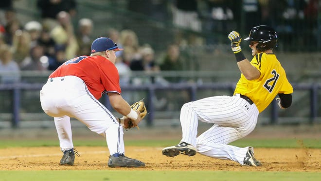 Ole Miss's Tyler Keenan (10) tags out Southern Mississippi's Hunter Slater (21) at third base. Ole Miss and Southern Mississippi played a college baseball game at Trustmark Park in Pearl on Tuesday, April 20, 2018. Photo by Keith Warren
