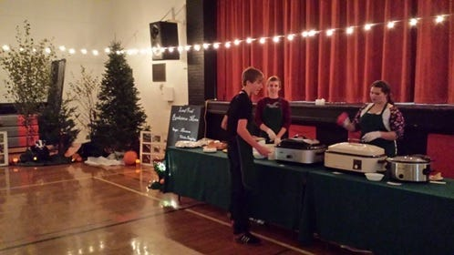Students help serve the food.