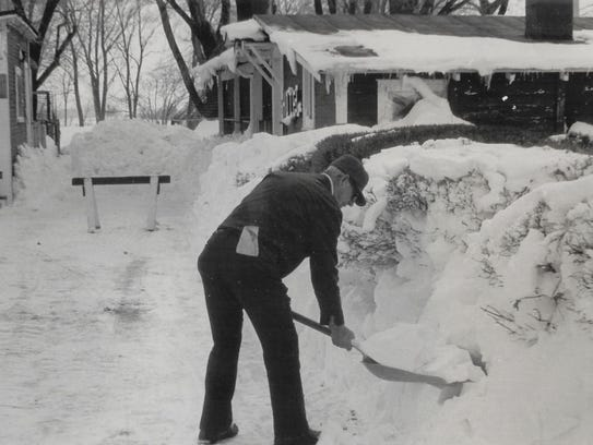 A man shovels snow near the Marion County Animal Shelter