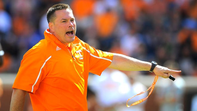 Coach Butch Jones directs his players as the University of Tennessee plays in the Orange and White game at Neyland Stadium. Saturday April 12, 2014, in Knoxville, TN.