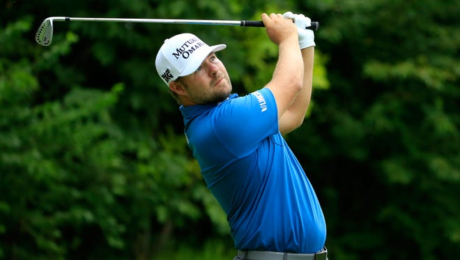 Ryan Moore plays his shot from the 16th tee during the continuation of the second round of the John Deere Classic Saturday at TPC Deere Run in Silvis, Ill.