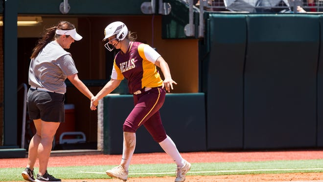Bells Bella Smith high-fives coach Kristina Stephens after hitting a home run during the fifth inning of the 2A state semifinal game against Albany at McCombs Field in Austin on Wednesday. Bells won the matchup, 13-0.
