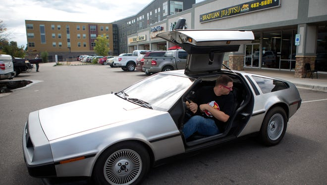 In this file photo, Alex Morgan, owner of Totally 80's Pizza, parks his DeLorean in front of the restaurant and museum in Fort Collins Monday, Sept. 22, 2014.