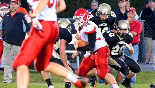Riverheads' Kendall Casto weaves his way through Buffalo Gap defenders as he runs the football for more yards during the first half of a football game played in Swoope on Friday, Sept. 26, 2014.