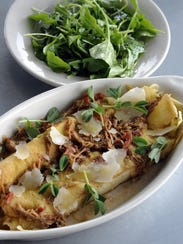 Manicotti di crespelle, seasonal preparation, served