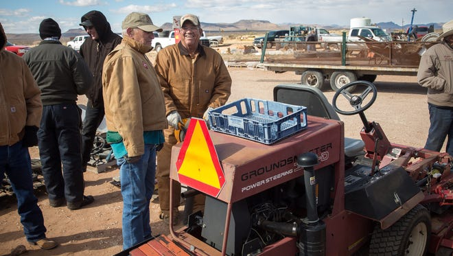 Visitors chat and check out a variety of items up for auction at the Annual Construction Equipment, Farm Machinery and Vehicle Auction at the Southern New Mexico Fairgrounds on Tuesday.