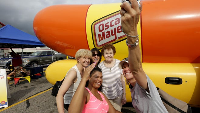 Jacob Byk/USA TODAY NETWORK - WisconsinFrom right: Linda Yach, Dolores Yach, Anita Ross, Alyssa Ross and Joanna Guttenfried take a selfie with the Oscar Mayer Weinermobile Friday at Trigs grocery store. From right: Linda Yach, Dolores Yach, Anita Ross, Alyssa Ross, and Joanna Guttenfried take a selfie with Oscar Mayer Weinermobile at Trigs grocery store, August 19, 2016.