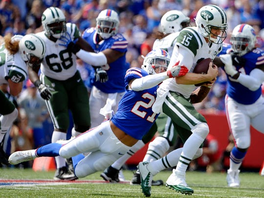 New York Jets quarterback Josh McCown (15) is sacked by Buffalo Bills' Jordan Poyer (21) during the first half of an NFL football game Sunday, Sept. 10, 2017, in Orchard Park, N.Y. (AP Photo/Adrian Kraus)