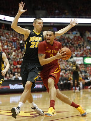 Iowa State's Abdel Nader drives to the basket as Iowa's Jarrod Uthoff defends in the first half of the  CyHawk game at Hilton Auditorium Thursday, Dec. 10, 2015.