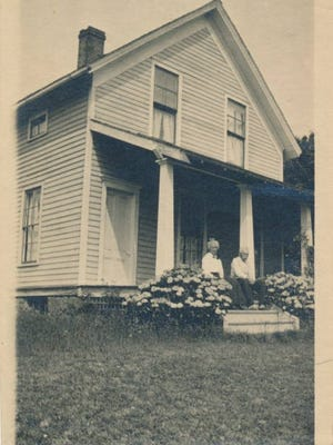 The original owners of the Carman House pose for a photo taken between 1920-1930.
