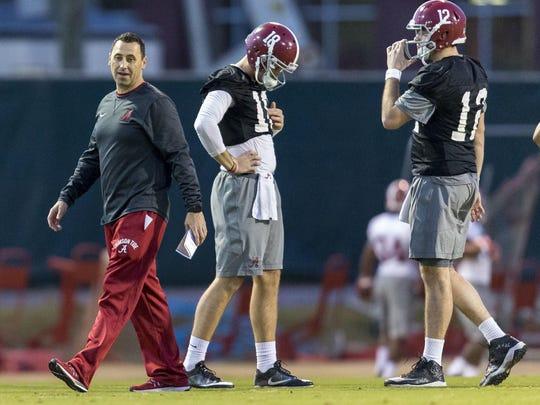 Alabama offensive coordinator Steve Sarkisian works with his players, including quarterbacks Cooper Bateman (18) and David Cornwell (12) on Tuesday in Tuscaloosa.