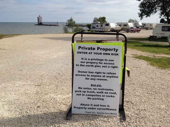 A new sign clarifying Sunrise Cove Marina and Campground owners' concerns was posted at the entrance to the parking area late this week.