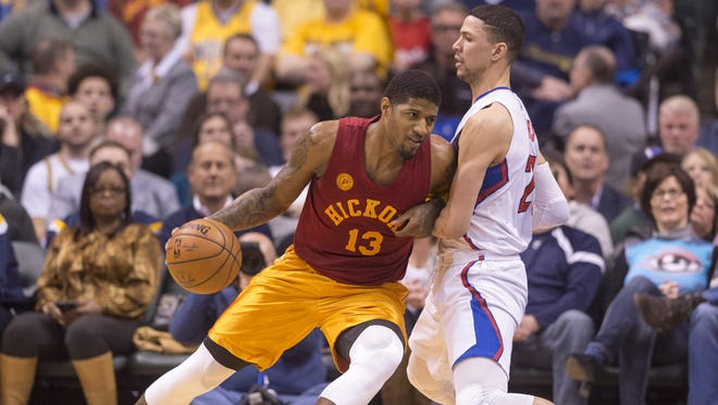 Indiana Pacers forward Paul George (13) drives the ball toward the basket against the defense of Los Angeles Clippers guard Austin Rivers (25) during the second half of an NBA basketball game, Tuesday, Jan. 26, 2016, at Bankers Life Fieldhouse in Indianapolis. The Clippers won, 91-89.