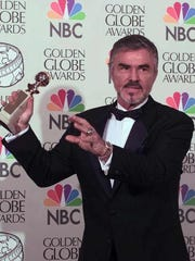 Burt Reynolds holds his award for Best Supporting Actor