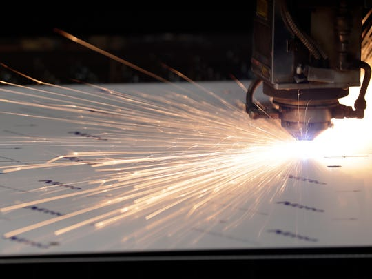 A laser cutter is shown in operation at American-3 Fab on Friday, June 15, 2018 in De Pere, Wis.