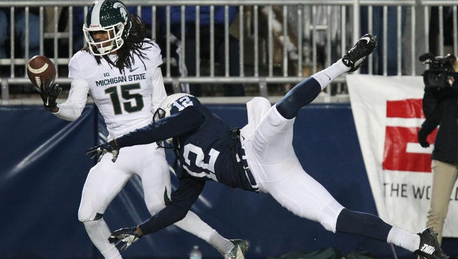 Michigan State cornerback Trae Waynes intercepts the ball during the second quarter against the Penn State Nittany Lions at Beaver Stadium.