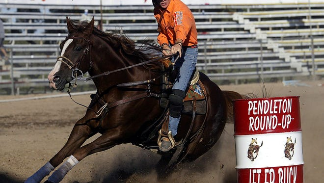 In this Sept. 13, 2002, file photo, Kristin Weaver, of Temecula, Calif., competes at the Pendleton Round-Up in Pendleton, Ore. The Pendleton Round-Up has been named the best large outdoor rodeo by the Professional Rodeo Cowboys Association for the second year in a row.