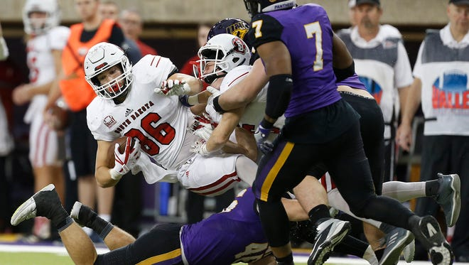 South Dakota's Josh Hale is brought down by Northern Iowa's Jared Farley.