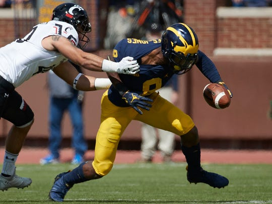 Sep 9, 2017; Ann Arbor, MI, USA; Michigan Wolverines receiver Donovan Peoples-Jones fields a punt and is tackled by Cincinnati Bearcats linebacker Ty Sponseller in the first half at Michigan Stadium.