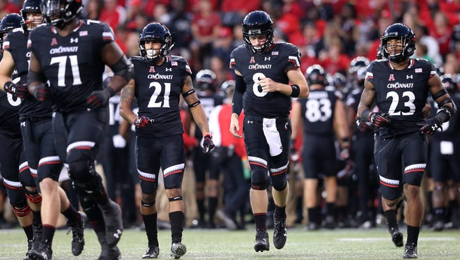Quarterback Hayden Moore (8) and the Cincinnati Bearcats face a tough assignment against No. 25 UCF on Saturday.
