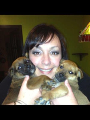 Gina Walthour with two of her foster puppies, Stubs and Stella.