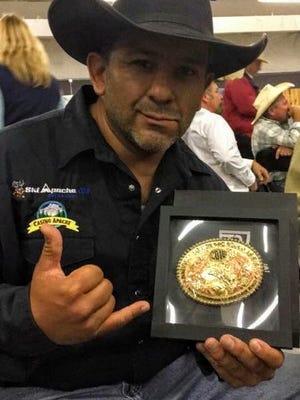 Mescalero resident J.R. Chino celebrates his 2016 National Senior Professional Rodeo World Bareback Championship title.
