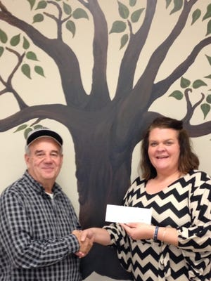 Melissa Polites, Director of Union County Senior Services recieves check from United Mine Workers of America District 2 Local 1793 member James A. Brantley.