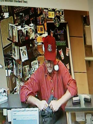 The Pima County Sheriff's Department is seeking the public's help in identifying a bank robber wearing a Santa hat.