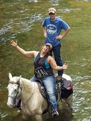 Anna Last and son John Dillion Blackman on the river.