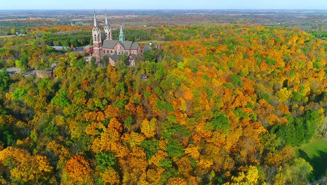 A canopy of fall colors surrounds The Basilica of the National Shrine of Mary, Help of Christians, at Holy Hill near Hubertus on Oct. 19.