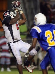 Wakulla's Nigel Bradham (2) makes a catch against Rickards