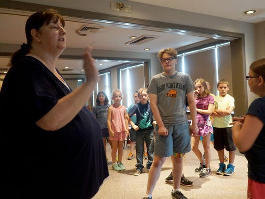 Dauphne Maloney instructs children during the Camp Broadway program in the Renaissance Theatre's ballroom Tuesday.