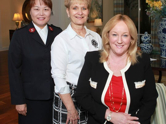 Captain Christine Kim, Corps Officer of the Salvation Army of Martin County, with Luncheon Committee co-chairs Vicki Davis and Carolyn Timmann