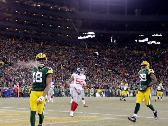 Green Bay Packers wide receiver Randall Cobb (18) celebrates after scoring a touchdown in the third quarter against the New York Giants as the Packers host the Giants in an NFC Wildcard game at Lambeau Field on Sunday, January 8, 2017, in Green Bay, Wis. The Packers defeated the Giants, 38-13.