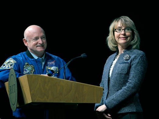 Left, Mark Kelly and former Rep. Gabrielle Giffords answer questions at RIT.
