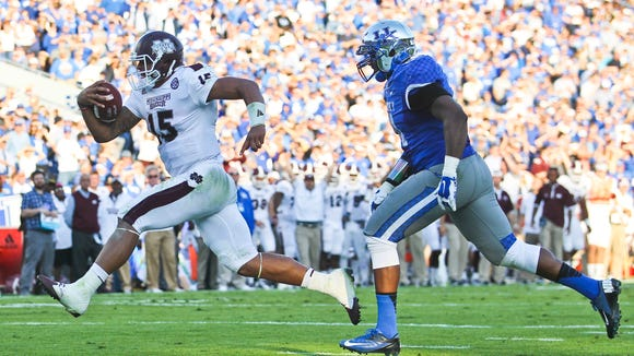 Miss State's Dak Prescott charges into the end zone with authority early in the third-quarter to put up the Bulldogs 24-10 Saturday at Commonwealth Stadium. Oct. 25, 2014 By Matt Stone/The C-J
