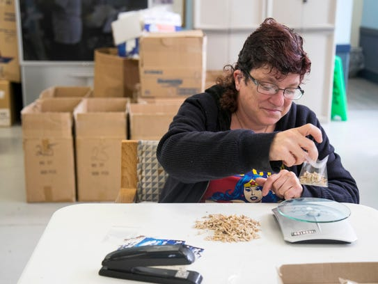 Amy Lebin packages shark teeth on Wednesday at LARC