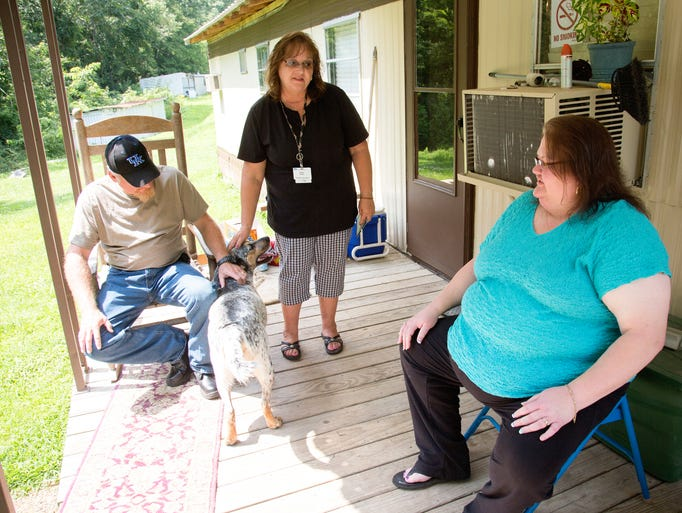Community health worker Shirley Prater, center, with Kentucky Homeplace, visits with Tony and Alisha Blankenbeckler at their trailer home. Both Tony and Alisha receive help with their medical care.