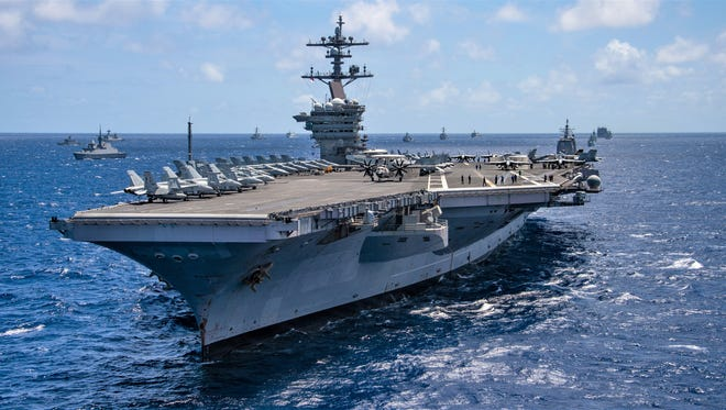 The aircraft carrier USS Carl Vinson participates in a group sail during the Rim of the Pacific exercise off the coast of Hawaii on July 26.