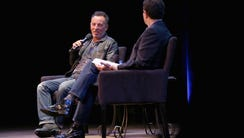 Bruce Springsteen (L) and journalist David Remnick