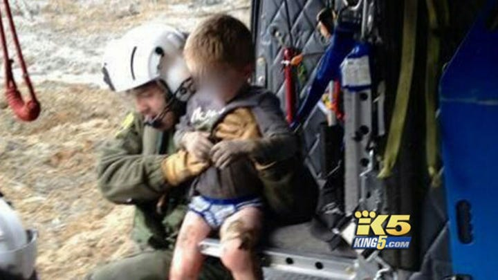 Boy rescued in mudslide, but search for family continues