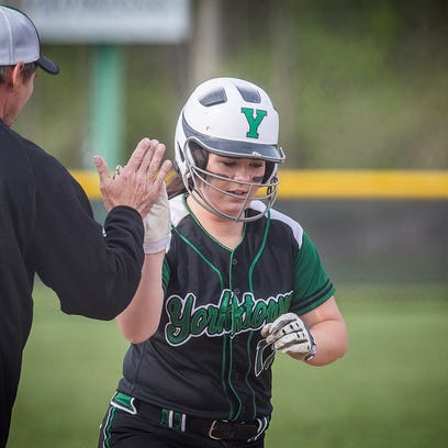 Yorktown's Isabel Moore is high-fived by head coach