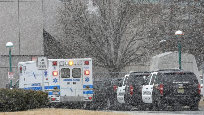 Linden, N.J. police department cars are parked near the emergency room exit of the Staten Island University Medical Center, Friday, March 20, 2015, in New York. Authorities say off-duty New Jersey police officers were involved in a wrong-way crash on Staten Island that has claimed two lives. (AP Photo/Mary Altaffer)