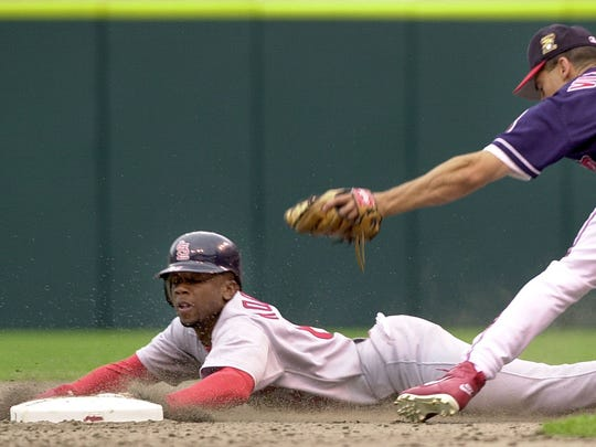 CLEVELAND, UNITED STATES:  St. Louis Cardinals' base runner Kerry Robinson (L) is out attempting to steal second base after being tagged by Cleveland Indians' shortop Omar Vizquel (R) in the eighth inning 07 July 2001 at the Jacobs Field in Cleveland, OH. Cleveland defeated St. Louis 7-6.