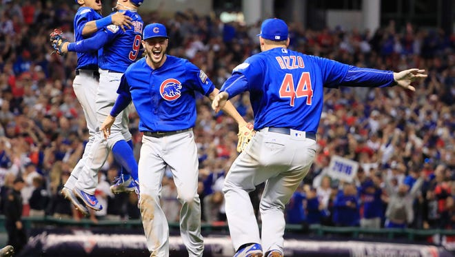 Chicago Cubs players celebrate the final out as the Cubs win the World Series over the Cleveland Indians at Progressive Field in Cleveland, Ohio, USA, 02 November 2016. (EPA/TANNEN MAURY)