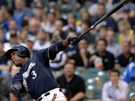 Milwaukee Brewers Yuniesky Betancourt hits a two run shot during the first inning of their game against the Texas Rangers  Tuesday, May, 7, 2013.