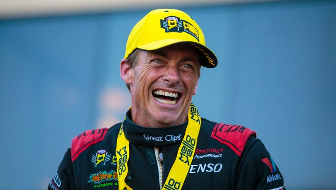 NHRA Top Fuel driver Clay Millican celebrates after winning the Route 66 Nationals at Route 66 Raceway.