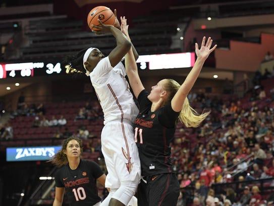 FSU's Shakayla Thomas takes a strong shot over a Virginia