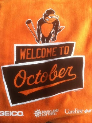 Flags handed out at Orioles' playoff game
